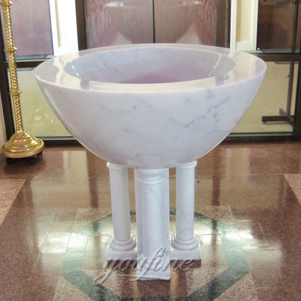 Indoor White Marble Catholic Small Baptismal Font in a Church on Stock